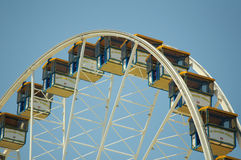 State Fair. Rides at the amusement park under bright blue sky Stock Photo
