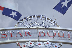 State Fair Texas sign and flags. State Fair Texas sign at Fair Park background royalty free stock image