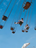 State Fair of Texas - Swing Ride. A young boy and girl swinging high above the State Fair of Texas on a rotating swing thrill ride royalty free stock photo