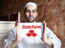 State Farm insurance logo. Logo of State Farm insurance company on samsung tablet holded by arab muslim man. State Farm is a large group of insurance and Stock Image