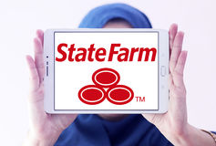 State Farm insurance logo. Logo of State Farm insurance company on samsung tablet holded by arab muslim woman. State Farm is a large group of insurance and Stock Photography