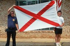 State flag of Alabama. Men with state flag of Alabama stock image