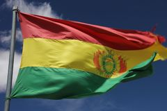 The state flag of Bolivia. Is flying over the salt desert of Salar de Uyuni, Bolivia royalty free stock photos