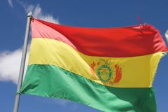 The Bolivian state flag in Salar Uyuni. The state flag of Bolivia is flying over the salt desert of Salar de Uyuni, Bolivia stock photography