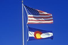 State Flag of Colorado. Against the blue stock image