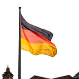 State Flag of Germany over Reichstag. Building tower in Berlin royalty free stock images