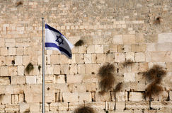 State Flag of Israel. Against the background of the Wailing Wall in Jerusalem, Israel stock photos