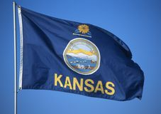 State Flag of Kansas. Against the sky royalty free stock image