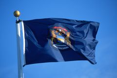 State Flag of Michigan stock photos
