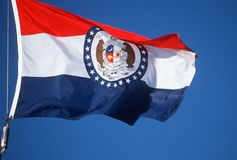 State Flag of Missouri. Against the sky Stock Image