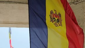 State flag of Moldova waving in slow motion stock video footage