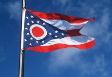 State Flag of Ohio. Against the blue sky stock photos