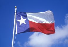 State Flag of Texas. Against the blue sky stock photos
