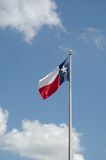 State Flag of Texas. Against the blue sky royalty free stock photo