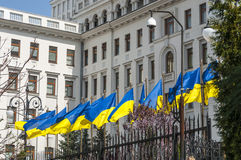 State Flag of Ukraine against the backdrop of the presidential palace in Kiev Royalty Free Stock Photo