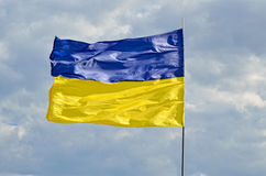 State flag of Ukraine against the blue sky. Yellow and blue symbol of freedom, patriotism and unbowed stock photos