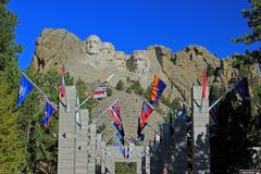 Flags at Mount Rushmore in South Dakota. State flags line the entrance to Mount Rushmore in South Dakota on a clear sunny day stock image