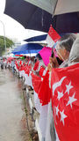 State Flags for LKY's funeral procession. People holding Singapore's national flag while waiting for Mr Lee Kuan Yew's hearse to pass by to bid their final Royalty Free Stock Photos