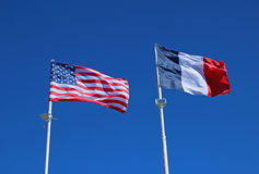 State flags of the United States of America and France. Against the blue sky royalty free stock images