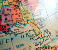 State of Florida focus macro shot on globe map for travel blogs, social media, web banners and backgrounds. State of Florida focus macro shot on globe map for stock images