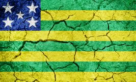 State of Goias, state of Brazil, flag. On dry earth ground texture background Stock Photo