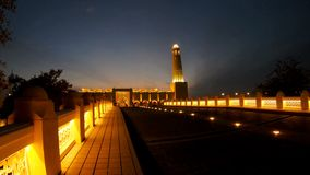 State Grand Mosque night. Lighted path towards State Grand Mosque illuminated at night in Doha Downtown, Middle East, Arabian Peninsula, Persian Gulf. Famous stock footage