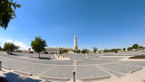 State Grand Mosque. Walkway towards State Grand Mosque and minaret in a sunny day with blue sky in Doha Downtown, Middle East, Arabian Peninsula, Persian Gulf stock footage