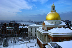State house snow. The golden dome of the massachusetts state house covered with snow after a winter storm is striking in this dramatic image Stock Photo
