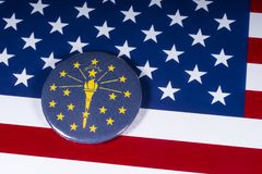 The State of Indiana in the USA. London, UK - November 20th 2018: The symbol of the State of Indiana, pictured over the flag of the United States of America royalty free stock photography