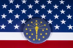 The State of Indiana in the USA. London, UK - November 20th 2018: The symbol of the State of Indiana, pictured over the flag of the United States of America stock photo