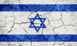 State of Israel flag. On dry earth ground texture background royalty free stock images