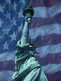 State of Liberty with American flag. Statue of Liberty with American national flag in background stock photography