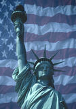 State of Liberty with American flag. Statue of Liberty with American national flag in background stock image
