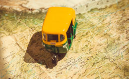 State Madhya Pradesh and Rajasthan on Indian roads map with driving toy model of traditional auto-rickshaw vehicle. Stock Photography