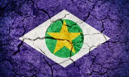 State of Mato Grosso, state of Brazil, flag. On dry earth ground texture background Stock Photo