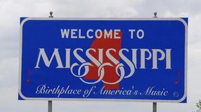 A sign at the Mississippi border. A state of Mississippi sign at the border of the state royalty free stock photography