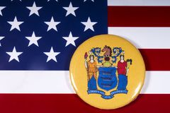 The State of New Jersey in the USA. London, UK - November 15th 2018: The coat of arms of the State of New Jersey, pictured over the flag of the United States of stock images