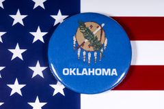 State of Oklahoma in the USA. London, UK - November 15th 2018: The symbol of the state of Oklahoma, pictured over the flag of the United States of America stock images