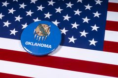 State of Oklahoma in the USA. London, UK - November 15th 2018: The symbol of the state of Oklahoma, pictured over the flag of the United States of America stock image