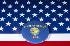 The State of Oregon in the USA. London, UK - November 20th 2018: The symbol of the State of Oregon, pictured over the flag of the United States of America royalty free stock images