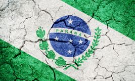 State of Parana, state of Brazil, flag. On dry earth ground texture background Stock Photos