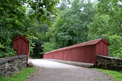 The red foot bridge. This state park has several foot bridges Stock Photos