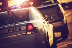 State Police Traffic Stop. On a Highway. Police Cruiser with Flashing Lights Royalty Free Stock Photos