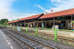 State railway station in Thailand. DONG MUEANG, THAILAND - 21 NOV 2013: Railway station with people on outdoor platforms Royalty Free Stock Images