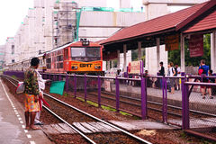 State Railways of Thailand SRT orange diesel electric train locomotive parked at Donmuang railway station Stock Photo