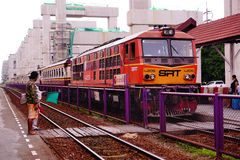 State Railways of Thailand SRT orange diesel electric train locomotive parked at Donmuang railway station Stock Image