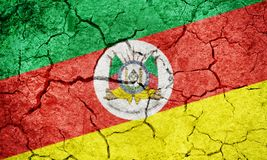 State of Rio Grande do Sul, state of Brazil, flag. On dry earth ground texture background Stock Photo