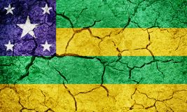 State of Sergipe, state of Brazil, flag. On dry earth ground texture background Stock Photos
