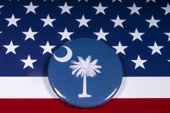 The State of South Carolina. London, UK - November 15th 2018: The symbol of the State of South Carolina, pictured over the flag of the United States of America royalty free stock image