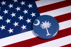 The State of South Carolina. London, UK - November 15th 2018: The symbol of the State of South Carolina, pictured over the flag of the United States of America royalty free stock photography
